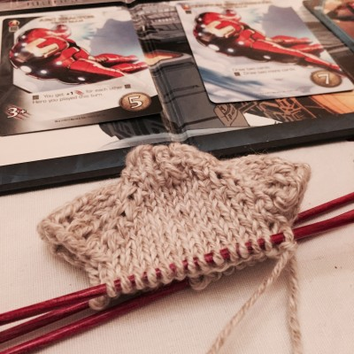 Knitting a tiny ornament and playing Legendary