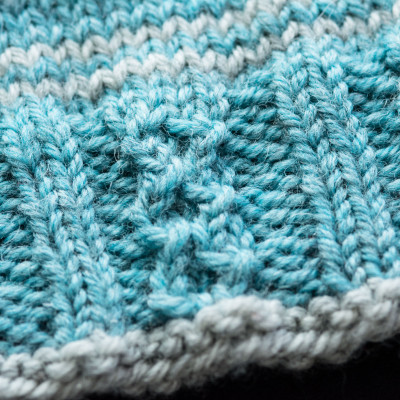Pomball: Waves hat pattern for knitters from Imagined Landscape Designs