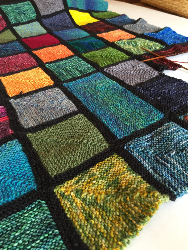 Coming soon - the Rainbow Windows blanket pattern for a join-as-you-go mitred square blanket pattern