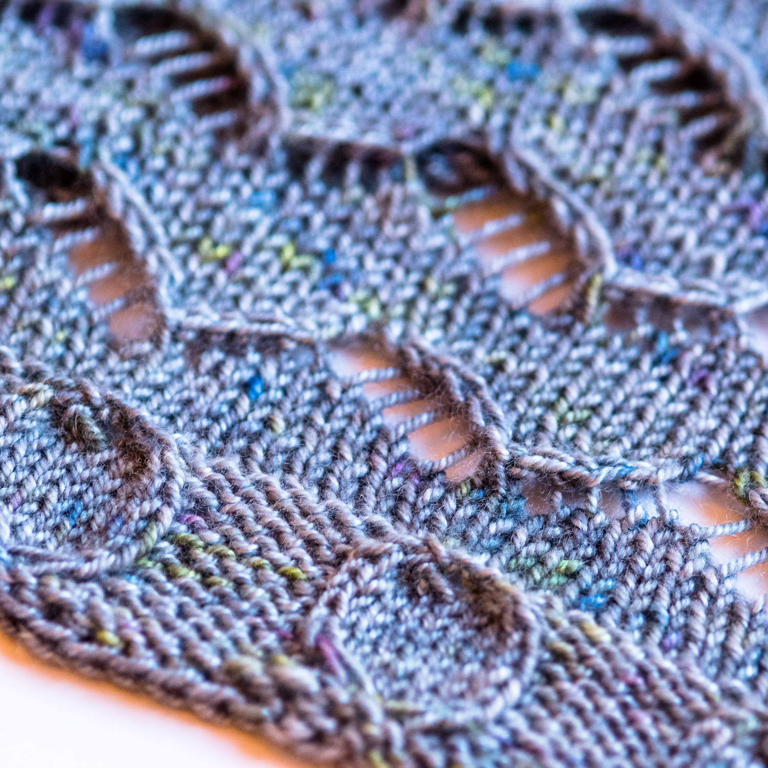 Street Art Cowl - A knitting pattern from Imagined Landscapes Designs. One skein project that looks like a shawl but wears like a cowl! Lace and cables
