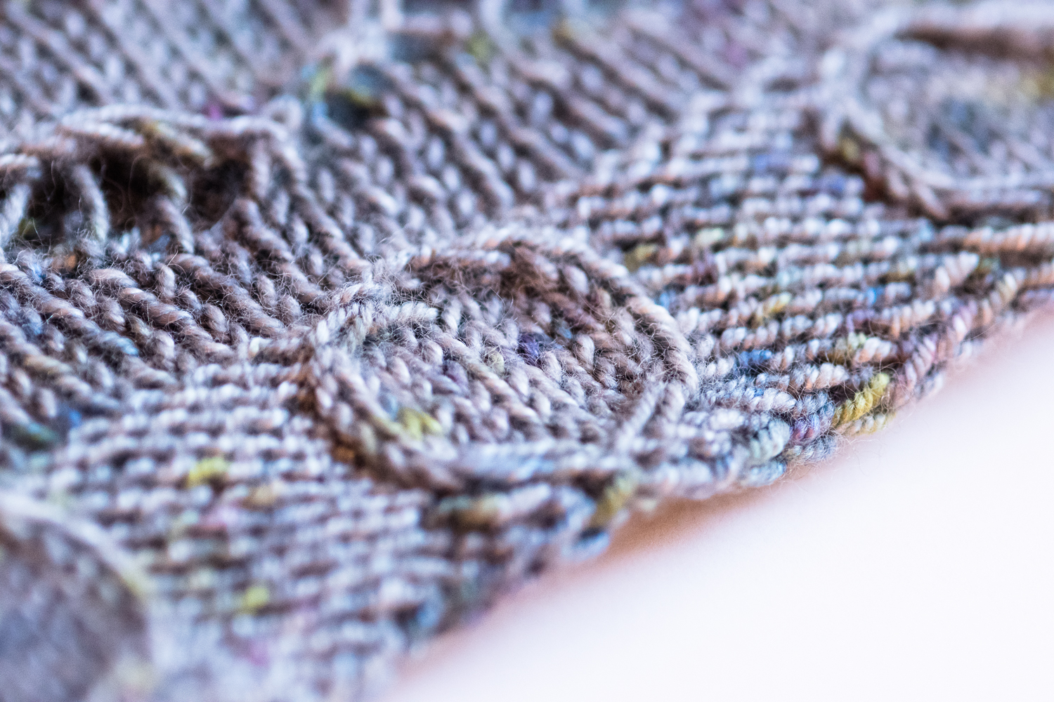 Street Art Cowl - A knitting pattern from Imagined Landscapes Designs. One skein project that looks like a shawl but wears like a cowl! Gorgeous and unusual circular cables on the edging