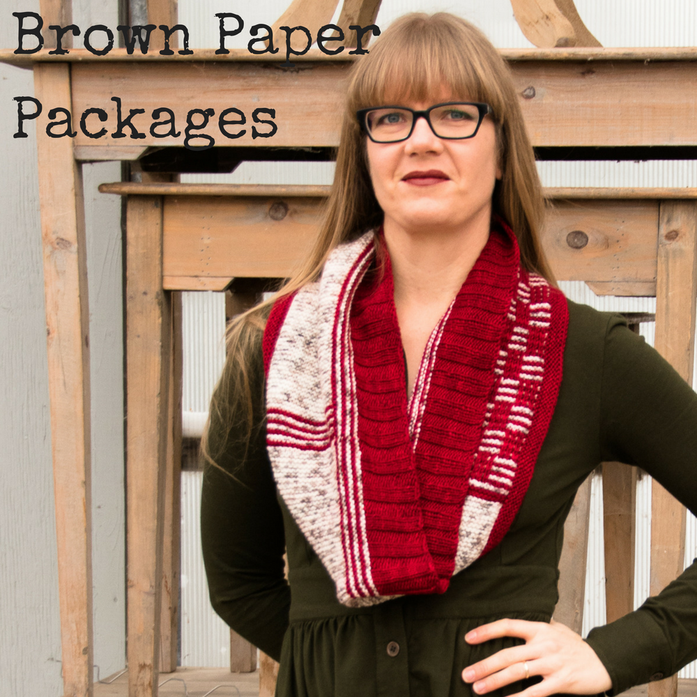 Brown Paper Packages Cowl - A knitting pattern for DK weight yarn featuring easy stripes and slipped stitches from Imagined Landscapes Designs. Three Irish Girls yarn in Springvale DK - Mister Heat Miser and Birch
